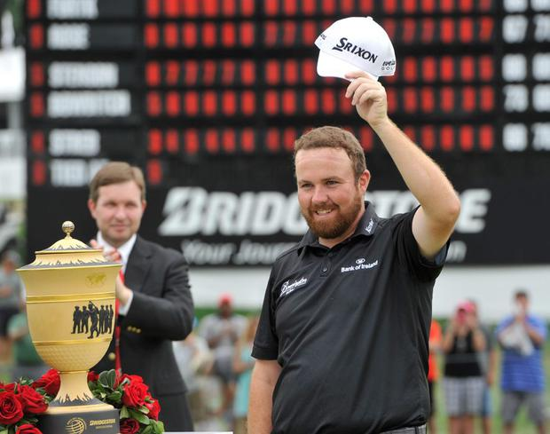 Shane Lowry waves to the crowd after winning the Bridgestone Invitational golf tournament, in Akron, Ohio