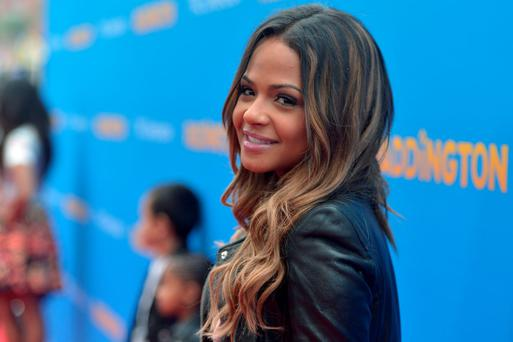 Actress Christina Milian arrives on the red carpet for the premiere of TWC-Dimension's