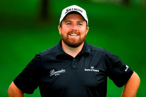 Shane Lowry of Ireland looks on from the 18th green after winning the World Golf Championships - Bridgestone Invitational during the final round at Firestone