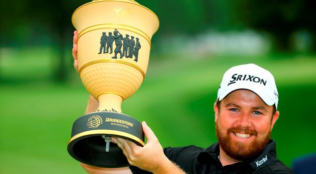 Shane Lowry of Ireland holds the Gary Player Cup after winning the World Golf Championships - Bridgestone Invitational during the final round at Firestone