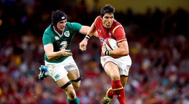 Wales' James Hook in action with Ireland's Tommy ODonnell