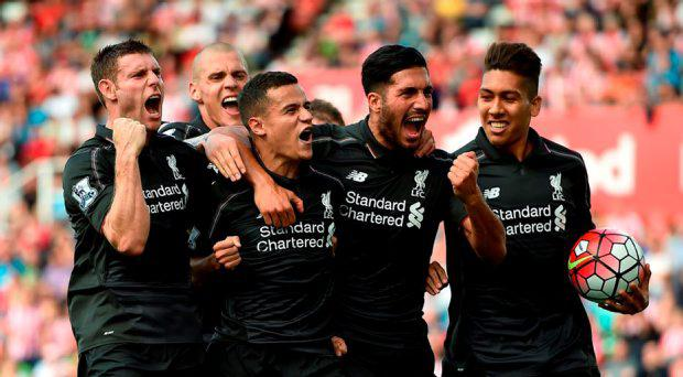 Liverpool's Philippe Coutinho (second left, front) celebrates scoring his side's first goal of the game during the Barclays Premier League match at the Britannia Stadium, Stoke-on-Trent