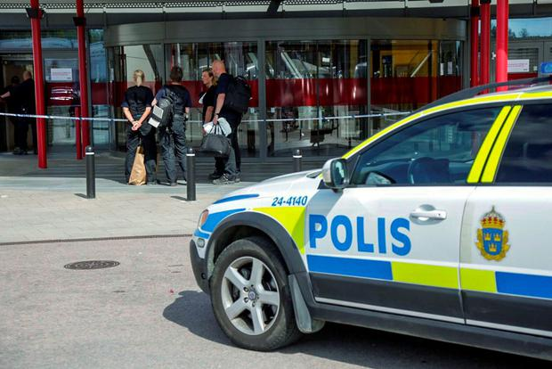 Police officers attend the Ikea store in Vasteras, Sweden, after three people were injured in a knife attack at the store. (Peter Kruger/TT via AP)