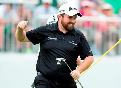 Shane Lowry celebrates after sinking a birdie putt on the eighteenth hole to win the Bridgestone Invitational at Firestone