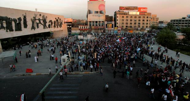 People shout slogans during a demonstration to show support for Iraqi Prime Minister Haider al-Abadi at Tahrir Square in central Baghdad