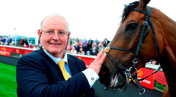 Gordon Lord Byron and trainer Tom Hogen during day two of the Irish Derby Festival at the Curragh Racecourse