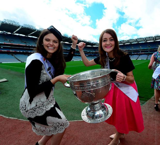 Dublin Rose Aisling Finnegan and Kerry Rose Julett Culloty do battle over the Sam Maguire cup during a visit to Croke Park. Photo: Domnick Walsh
