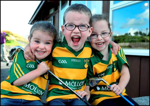 Amy (2), Sean (4) and twin sister Edel Gillespie from Ballinamere, Co Offaly, celebrating Shane Lowry's win at Esker Hills Golf Club near Clara. Photos: Steve Humphreys