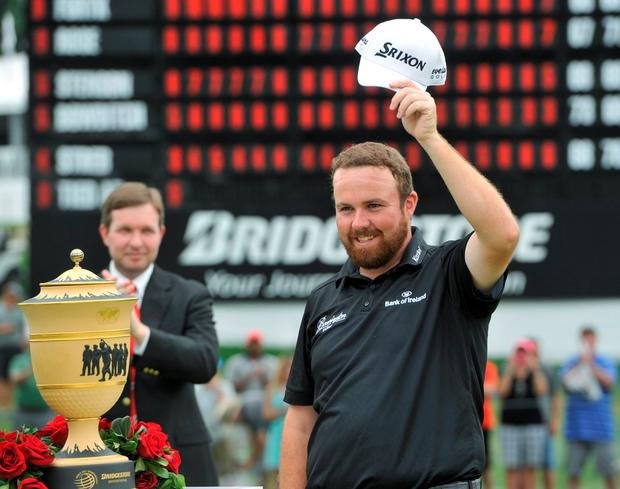 Shane Lowry waves to the crowd after winning the Bridgestone Invitational golf tournament in Akron, Ohio.