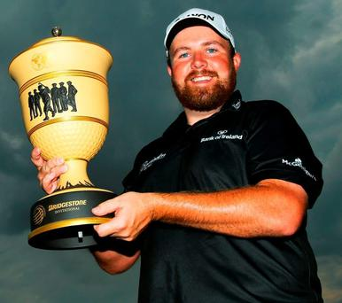 Shane Lowry holds the Gary Player Cup after winning the WGC-Bridgestone Invitational on Sunday night GETTY