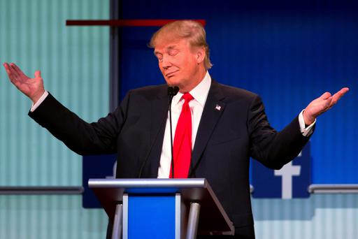 Republican presidential candidate Donald Trump gestures during the first Republican presidential debate at the Quicken Loans Arena. Photo: AP Photo/John Minchillo