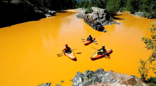People kayak in the Animas River near Durango, Colo., Thursday, Aug. 6, 2015, in water colored from a mine waste spill. Photo: Jerry McBride/The Durango Herald via AP