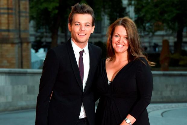 Louis Tomlinson and Johannah Poulston attend the Believe in Magic Cinderella Ball at Natural History Museum on August 10, 2015 in London, England. (Photo by Stuart C. Wilson/Getty Images)