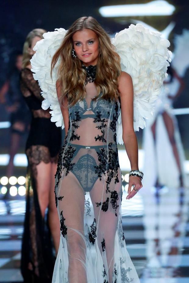 Model Kate Grigorieva wears Victoria's Secret Designer Collection Bra and Matching Panty, Silk Dress with Applique with Swarovski crystals, Feather Wings during the runway at the 2014 Victoria's Secret Runway Show