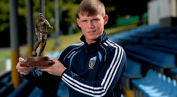 UCD's Ryan Swan with his SSE Airtricity player of the month award for July 2015.