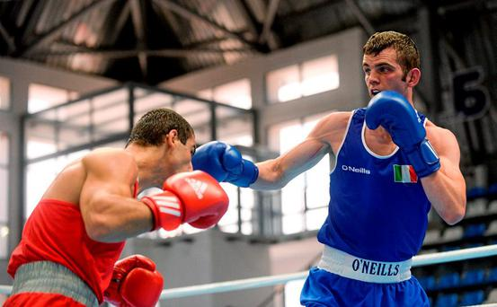 11 August 2015; Adam Nolan, Ireland, right, exchanges punches with Radzhab Butaev, Russia, during their 69kg Welterweight preliminary bout. EUBC Elite European Boxing Championships, Samokov, Bulgaria. Picture credit: Pat Murphy / SPORTSFILE