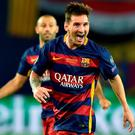 Barcelona's Argentinean forward Lionel Messi celebrates after scoring tonight