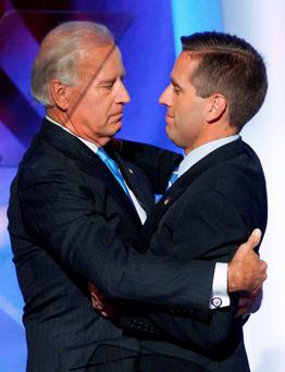 Joe Biden, pictured hugging his son Beau at the 2008 Democratic National Convention in Denver, is considering a presidential bid for the Democrats as Hillary Clinton has been losing ground in the polls to Republican rivals.