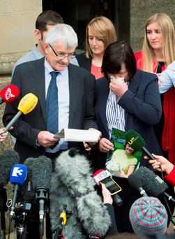John Buckley reads out a statement with his wife Marian Buckley outside Glasgow High Court