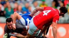 Monaghan's Kieran Hughes tussles with Tyrone duo Cathal McCarron (4) and Niall Morgan