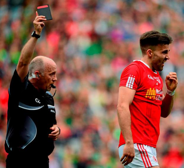 Marty Duffy shows the black card to Tyrone's Tiernan McCann during Saturday's victory over Monaghan