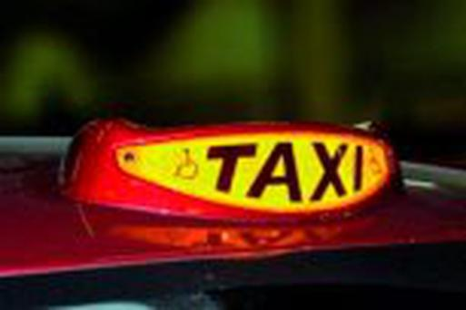 A common British taxi sign. A study has found that the larger signs add as much as 50pc to a taxi's fuel costs