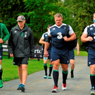 Ireland players, from left, Ian Madigan, head coach Joe Schmidt, Nathan White and Michael Bent arrive for squad training