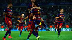 Lionel Messi is congratulated by Luis Suarez after scoring his second goal