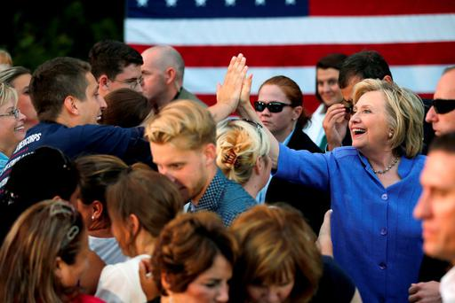 US Democratic presidential candidate Hillary Clinton high-fives a supporter at a campaign stop in Manchester, New Hampshire. Photo: Reuters