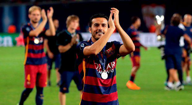 Barcelona's Pedro Rodriguez applauds the supporters after winning the UEFA Super Cup soccer match between FC Barcelona and Sevilla FC at the Boris Paichadze Dinamo Arena stadium, in Tbilisi, Georgia, on Wednesday, Aug. 12, 2015. Barcelona won 5-4