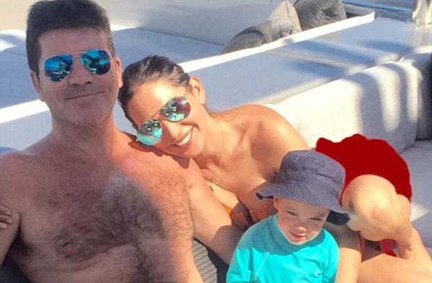 Simon Cowell with girlfriend Lauren Silverman and their son Eric