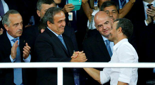 UEFA President Michel Platini (L) congratulates Barcelona's coach Luis Enrique who celebrates the victory over Sevilla in the UEFA Super Cup soccer match at Boris Paichadze Dinamo Arena in Tbilisi, Georgia, August 12, 2015