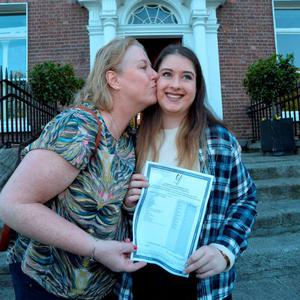 12 Aug 2015: Hayley Briody, 17, from Drumree, Co. Meath, gets a kiss from her mother Shelia after receiving her Leaving Cert results (and 595 points). Loreto College, St. Stephen's Green, Dublin. Picture: Caroline Quinn