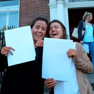 12 Aug 2015: Katie McGuinness, left, 18, from Swords, and Sian Walton, 18, from Ashbourne, after receiving their Leaving Cert results. Loreto College, St. Stephen's Green, Dublin. Picture: Caroline Quinn