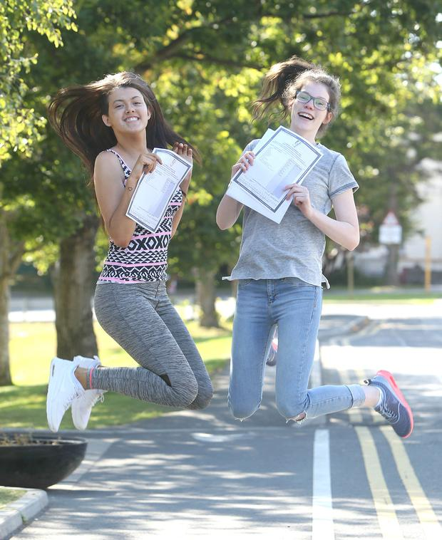 Shanuna Byrne, 19, left, and Sinead Power celebrate after receiving their Leaving certificate results at St Raphaelas Secondary School in Stillorgan. Picture credit; Damien Eagers 12/8/2015