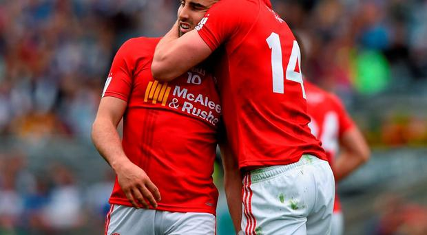 Tiernan McCann is embraced by Tyrone team-mate Sean Cavanagh during Saturday's All-Ireland SFC quarter-final SPORTSFILE