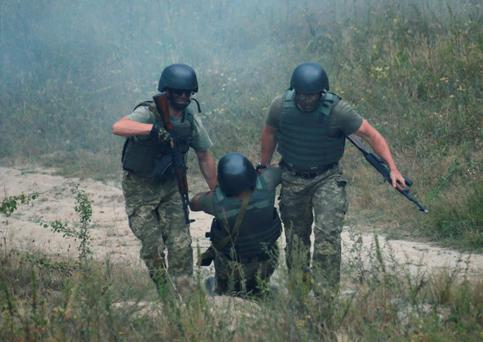 Ukrainian servicemen take part in a military drill at a shooting range near Zhytomyr. British Defence Minister Michael Fallon has pledged to expand a British army training mission to Ukraine (Photo: Reuters)