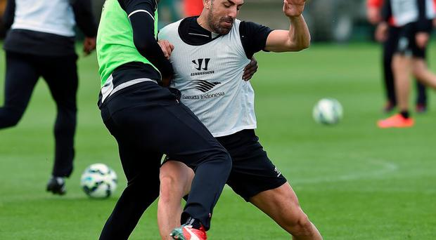 Liverpool left-back Jose Enrique says he has joined team-mates Mario Balotelli (pictured with Enrique) and Fabio Borini in being 'alienated' by Brendan Rodgers