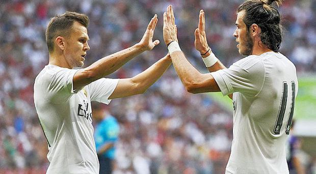 Denis Cheryshev with Gareth Bale