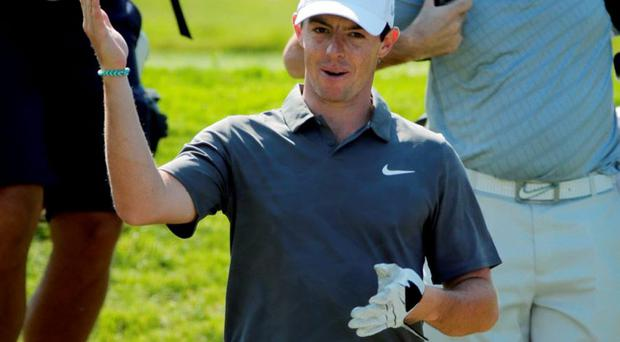 Rory McIlroy, of Northern Ireland, smiles during a practice round for the PGA Championship golf tournament Wednesday, Aug. 12, 2015, at Whistling Straits in Haven, Wis. (AP Photo/Jae Hong)