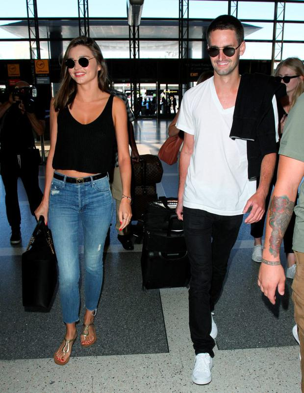 Miranda Kerr and Evan Spiegel are seen at LAX. on August 12, 2015 in Los Angeles, California. (Photo by GVK/Bauer-Griffin/GC Images)