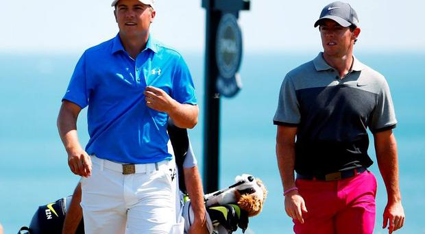 Jordan Spieth and Rory McIlory walk down a fairway at Whistling Straits on their way to a pair of first round 71s
