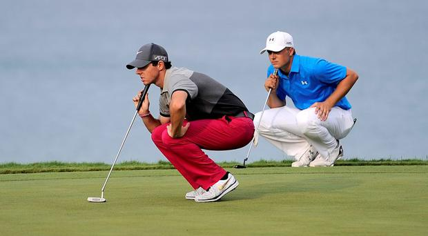 Rory McIlroy and Jordan Spieth line up their putts on the 16th green during the first round of the 2015 PGA Championship golf tournament at Whistling Straits.