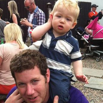 Tragic toddler Oliver Scullion with brewery boss dad Owen