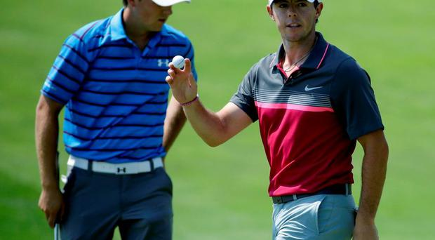 Rory McIlroy, of Northern Ireland, reacts in front of Jordan Spieth, left, after McIlloy made a birdie putt on the sixth hole during the second round of the PGA Championship