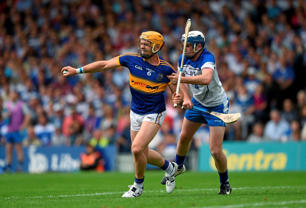 Padraic Maher, pictured winning a battle with Waterford's Stephen Bennett in the Munster final, is a key cog in the Tipperary defence that should lay the foundation for a Premier victory.
