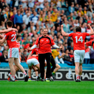 Tyrone captain Sean Cavanagh (No. 14) celebrates with selector Gavin Devlin (centre) and his team-mates after Saturday's victory over Monaghan