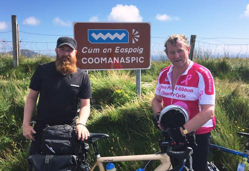 A pair of cyclists at their peak: Mark meets An Taoiseach, Enda Kenny, at the summit of Coomanaspic, Co. Kerry.