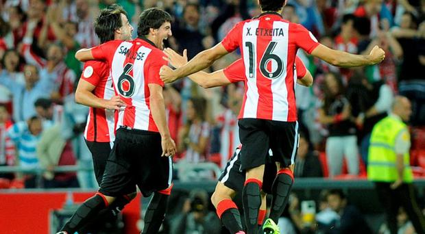 Athletic Bilbao's defender Mikel San Jose (2nd L) is congratulated by teammates midfielder Benat Etxebarria (L), midfielder Oscar de Marcos (3rd L) and defender Xabier Etxeita (R) after scoring during the Spanish Super Cup first-leg