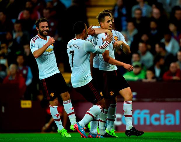 Manchester United players celebrate with Adnan Januzaj after the winger opened the scoring in the Premier League win at Villa Park last night